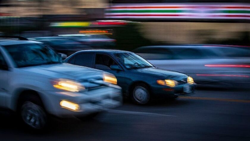 Traffic moves on Zelzah Avenue in Northridge on June 27.