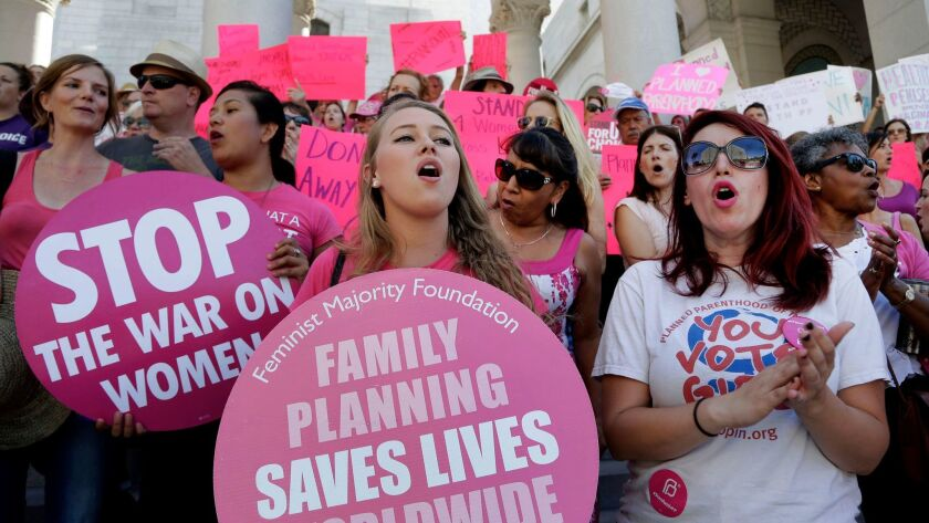 Planned Parenthood supporters rally for women's access to reproductive health care at Los Angeles City Hall on Sept. 9, 2015.