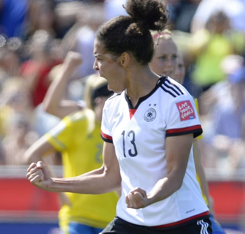 Germany's Celia Sasic (13) celebrates her goal against Sweden during the first half of a FIFA Women's World Cup soccer game in Ottawa, Ontario, on Saturday, June 20, 2015. (Justin Tang/The Canadian Press via AP) MANDATORY CREDIT