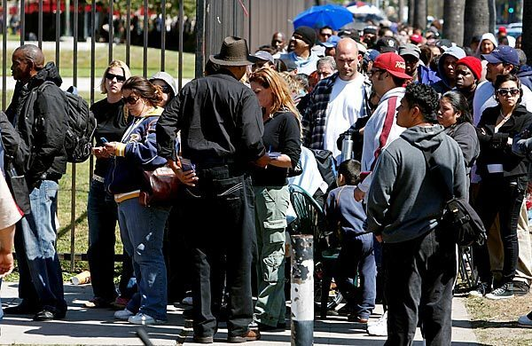 Thousands of people line the perimeter of the L.A. Sports Arena hoping to get wristbands for access to free medical care from Remote Area Medical's seven-day clinic. Only 1,200 wristbands were handed out Wednesday, leaving many disappointed and frustrated. Read complete free clinic coverage.