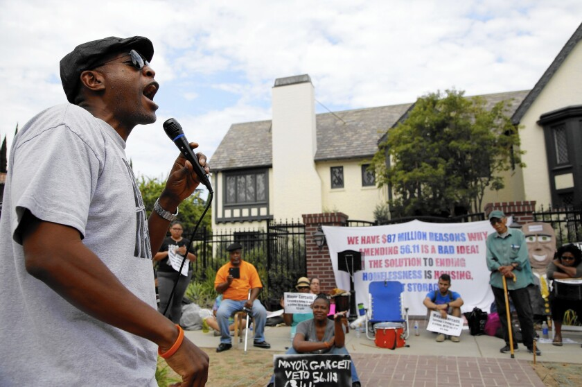 Pete White of the Los Angeles Community Action Network speaks during a demonstration Thursday in front of Mayor Eric Garcetti's residence over measures targeting homeless encampments.