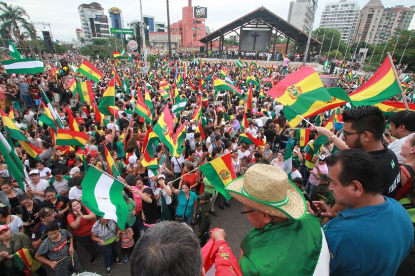 A celebration erupts in the streets of Santa Cruz, Bolivia, after the resignation of President Evo Morales on Nov. 10, 2019.