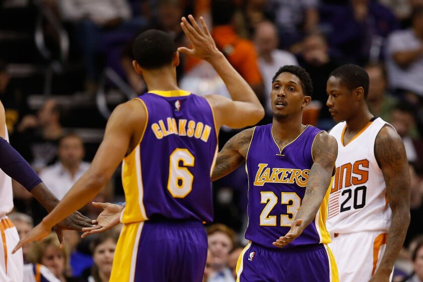 PHOENIX, AZ - NOVEMBER 16: Louis Williams #23 of the Los Angeles Lakers high fives Jordan Clarkson #6 after scoring against the Phoenix Suns during the NBA game at Talking Stick Resort Arena on November 16, 2015 in Phoenix, Arizona. The Suns defeated the Lakers 120-101. NOTE TO USER: User expressly acknowledges and agrees that, by downloading and or using this photograph, User is consenting to the terms and conditions of the Getty Images License Agreement. (Photo by Christian Petersen/Getty Images) ** OUTS - ELSENT, FPG, CM - OUTS * NM, PH, VA if sourced by CT, LA or MoD **