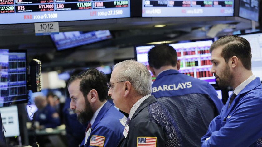 Traders work at the New York Stock Exchange on Thursday.