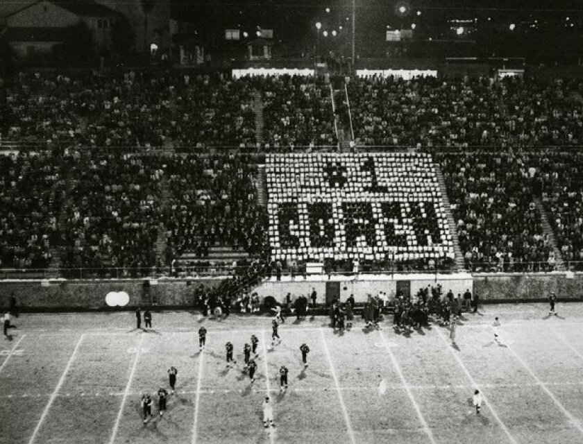 The San Diego State College Aztec football team and fans celebrate their head coach, Don Coryell, during a game at Aztec Bowl. Photo San Diego State University.