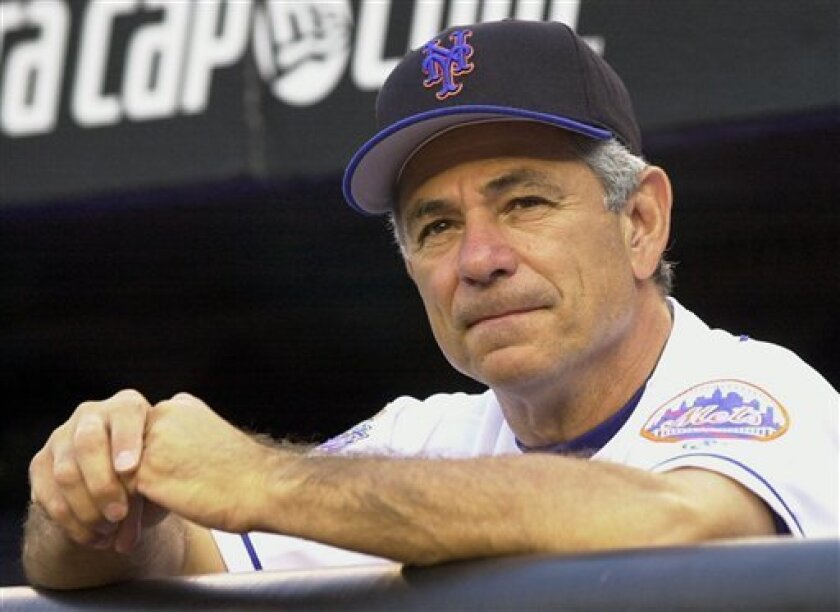 FILE-This Aug. 14, 2002 file photo shows New York Mets manager Bobby Valentine leaning on the dugout rail before their start against the San Diego Padres at Shea Stadium in New York. A person familiar with the decision says the Boston Red Sox have chosen Bobby Valentine to be their next manager and were working to complete a contract.The person spoke to The Associated Press on condition of anonymity Tuesday Nov. 29, 2011, because no announcement had been made. (AP Photo/Ron Frehm, File)