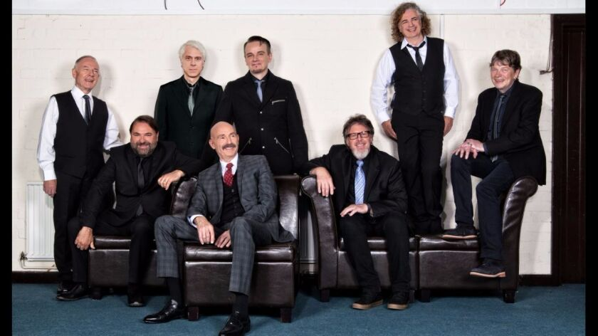The latest edition of King Crimson is headed by guitarist and band founder Robert Fripp (far left).