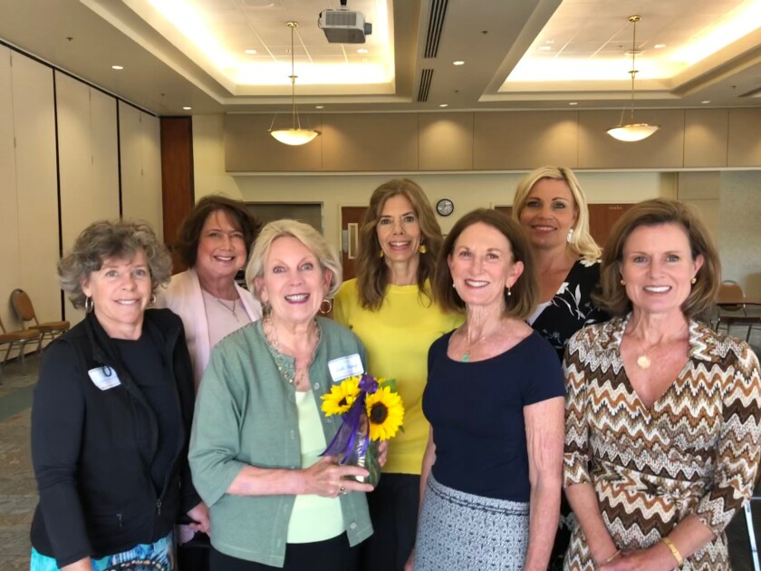 In early March, community members helped surprise San Dieguito Alliance with the award announcement: First row, left to right, Nancy Perry Sheridan, Judi Strang, Katie Poponyak, and Terri Ann Skelly. Second row, left to right, Janet Asaro, Kelly McCormick, and Becky Rapp.