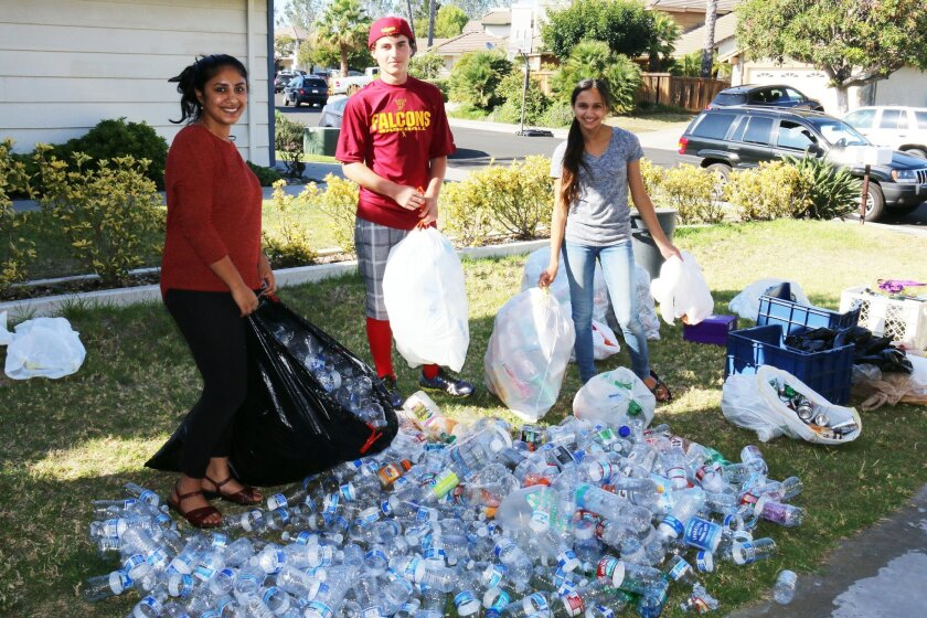 L-R: Friendly Falcons Junior Optimists Shyama Yallapragada, Zachary Hirsch, and Solana Garcia used the proceeds from recycling to help fund their activities.