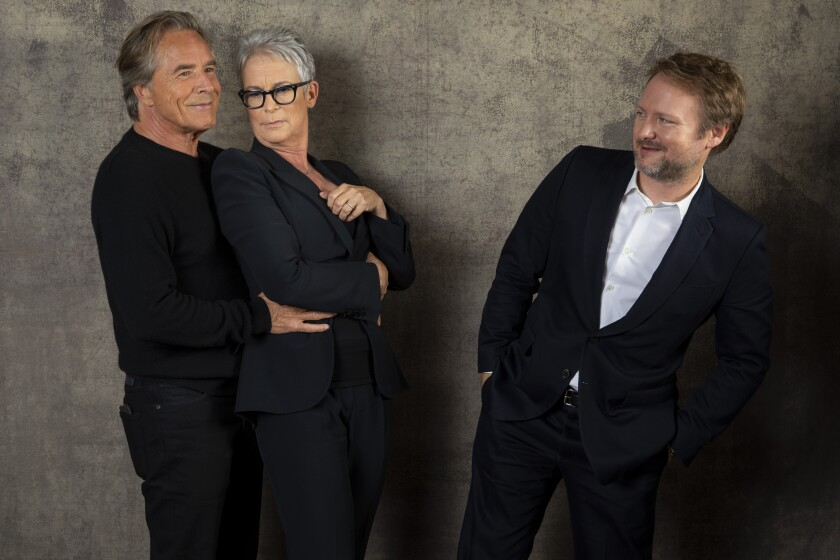 """Don Johnson and Jamie Lee Curtis with """"Knives Out"""" director Rian Johnson."""