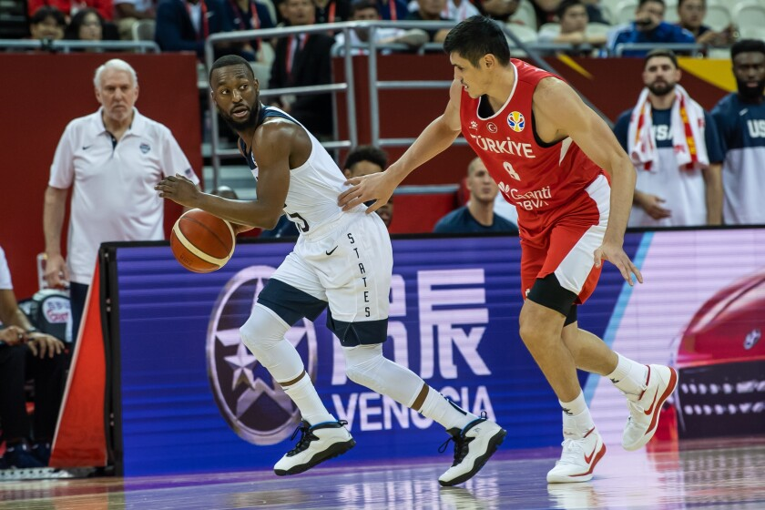 Kemba Walker of the U.S. tries to get past Turkey's Ersan Ilyasova as U.S. coach Gregg Popovich looks on Tuesday night during FIBA World Cup action in Shanghai.