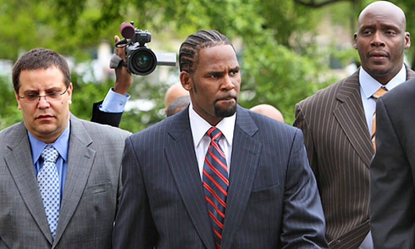R&B star R. Kelly, 41, arrives at the Cook County Criminal Courts Building for his child pornography trial Tuesday, May 20, 2008, in Chicago. A jury acquitted the R&B superstar on June 13, 2008. Read the story.