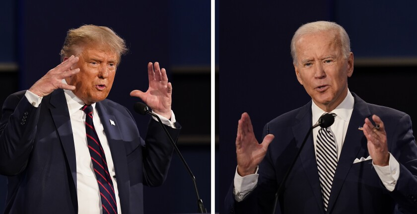 President Donald Trump, left, and former Vice President Joe Biden gesture during the first presidential debate.