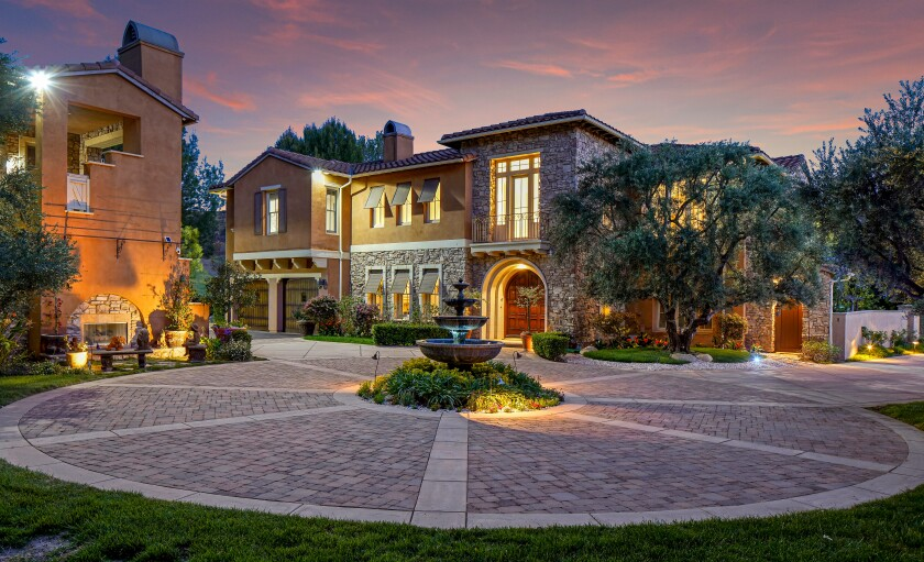 A motor court marks the front of a 3-acre Hidden Hills property