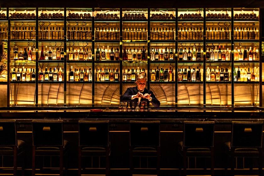 Leo Robitschek crafts cocktails behind the oh-so-civilized NoMad Bar.