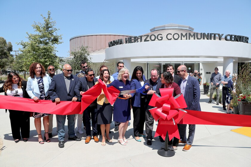 Costa Mesa Mayor John Stephens cuts the ribbon as he is joined by elected officials.