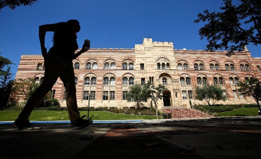 A pedestrian walks near the Humanities Building at UCLA. California banned race-conscious affirmative action in 1996.