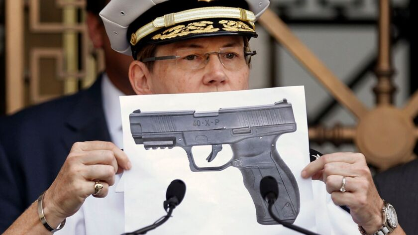 Columbus Police Chief Kim Jacobs holds up a photo showing the type of BB gun that police say a 13-ye