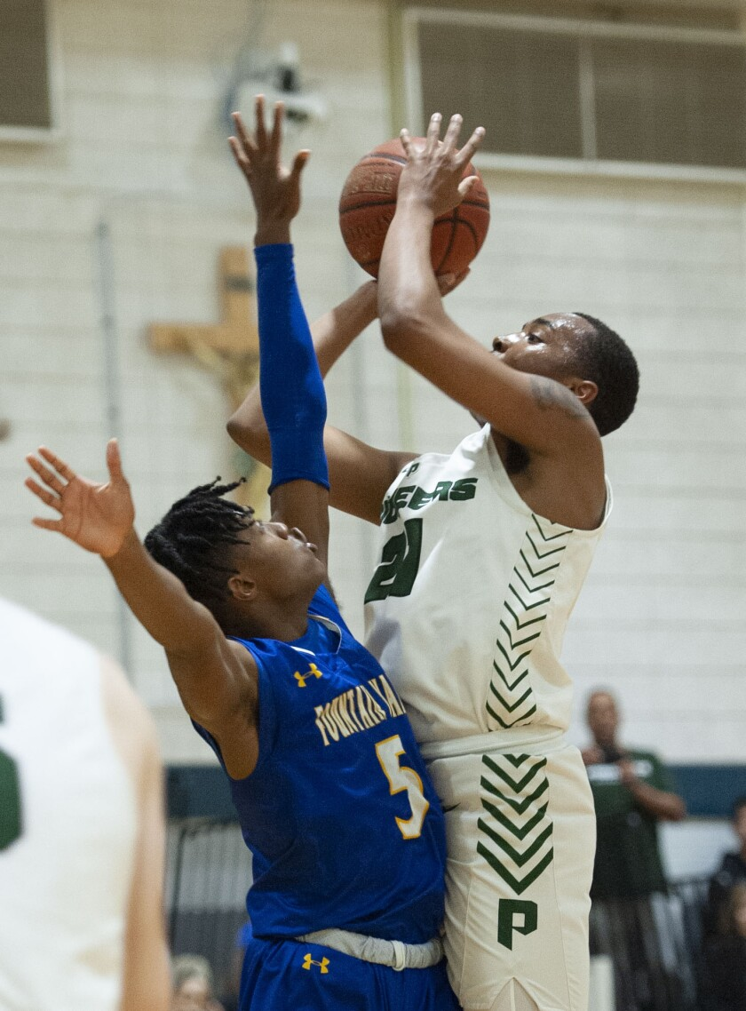 Providence High's A'Jahni Levias shoots the ball over Fountain Valley's Jermiah Davis during the CIF State Division III Southern California Regional semifinal at Providence High.