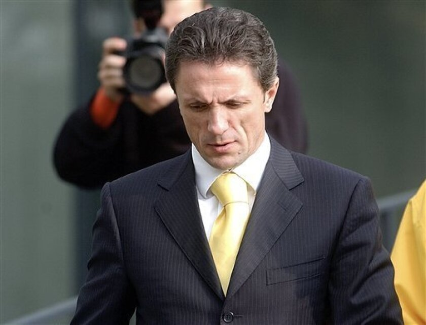 "FILE: In this Nov. 2005 file picture, former Romanian soccer star and captain of the Romanian national soccer team Gheorghe Popescu walks outside the Romanian soccer federation headquarters in Bucharest Romania. Gheorghe 'Gica' Popescu, a former FC Barcelona player, on Monday June 29, 2009, denied a newspaper report that he was an informer of the feared Communist secret police in the 1980s. Popescu, 41, who is one of Romania's best loved sporting figures, said he signed a document promising to ""defend the national interests"" during the regime of late dictator Nicolae Ceausescu. (AP Photo/Vadim Ghirda, File)"