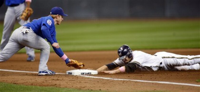 Milwaukee Brewers' Jason Kendall, right, is safe at third with a triple as Chicago Cubs' Mike Fontenot, left, is late with the tag in the second inning of a baseball game Sunday, May 10, 2009, in Milwaukee. (AP Photo/Darren Hauck)