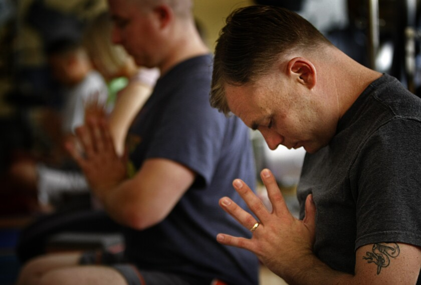 U.S. Marine Sgt. James Bernard, 25, who suffers from PTSD and a traumatic brain injury after deployments to Iraq and Afghanistan, meditates during a yoga class at the Naval Medical Center in San Diego, CA on June 10, 2013. Treatment for civilian contractors suffering from PTSD who worked in war-torn areas is rare.