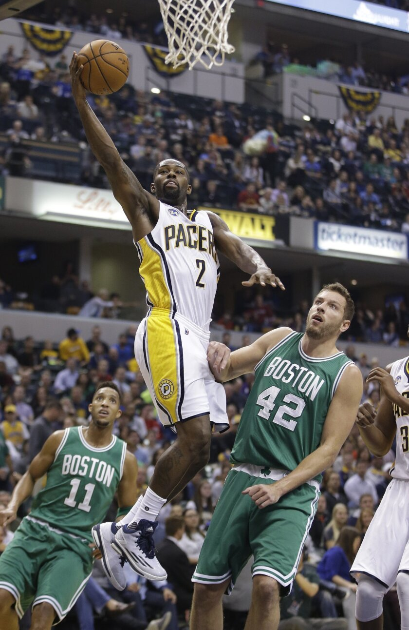 Indiana Pacers' Rodney Stuckey (2) shoots against Boston Celtics' David Lee (42) during the first half of an NBA basketball game Wednesday, Nov. 4, 2015, in Indianapolis. (AP Photo/Darron Cummings)