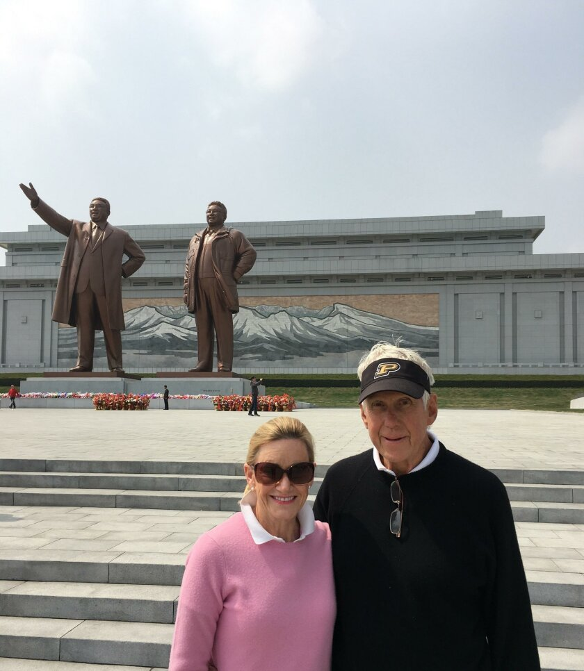 Gloria and Charlie McCoy at one of the tribute monuments to North Korean leaders.