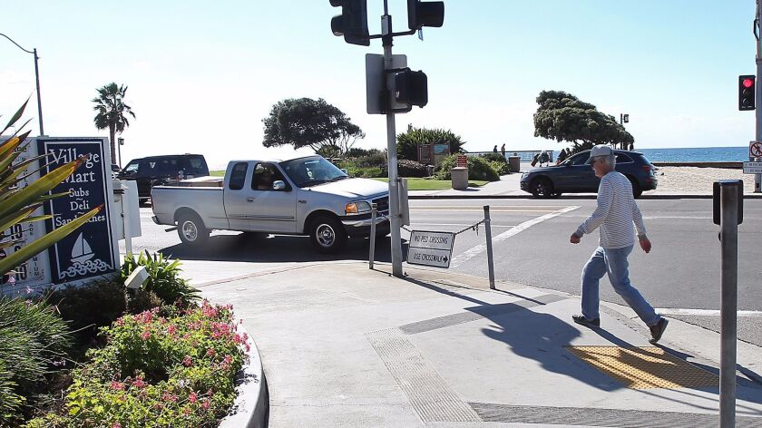 This 2015 photo was taken at the intersection of South Coast Highway and Broadway Street in Laguna Beach. The California Department of Transportation has begun repairing sidewalks in portions of Laguna and Newport Beach.