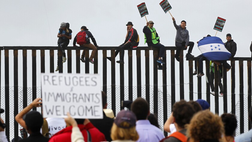 Protestors against asylum seekers being deported, gather for a rally in Sydney, Australia, Thursday, Feb. 4, 2016. Australia was resisting mounting international pressure not to deport child asylum seekers, with a minister warning on Thursday that allowing them to stay could attract more refugees t