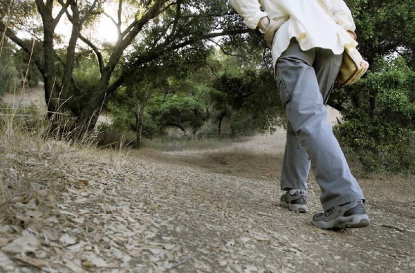 A hiker heads to Inspriation Point on the grounds of King Gillette Ranch.
