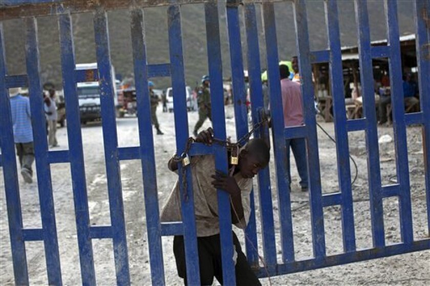 In this photo taken on Jan. 29, 2011, a Haitian boy tries to cross into the Dominican Republic at the Haitian/Dominican Republic border near Jimani. The largest campaign in years to deport Haitians living illegally in the Dominican Republic is causing widespread fear and prompting accusations that