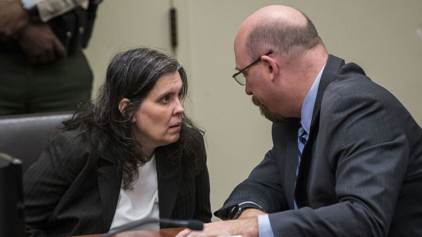 RIVERSIDE, CA - JANUARY 18, 2018: Louise Turpin,46, consults with her attorney Jeff Moore before she
