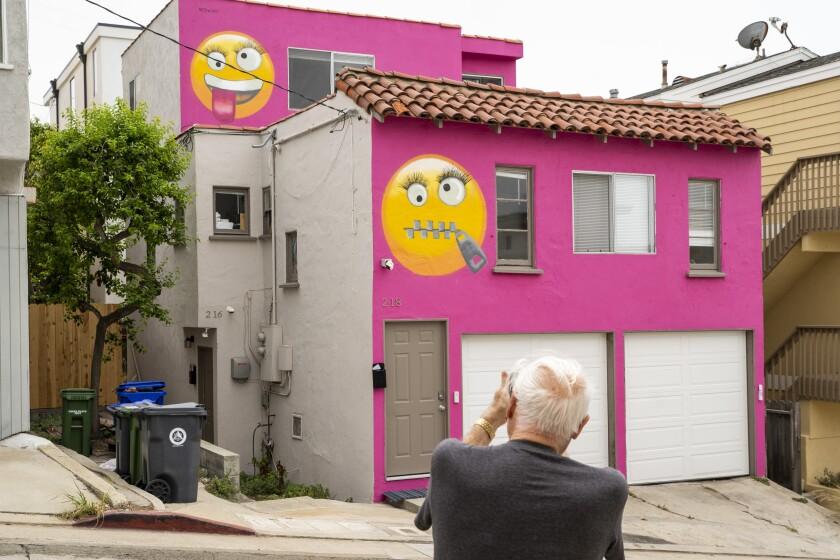 "A man photographs the ""Emoji House"""