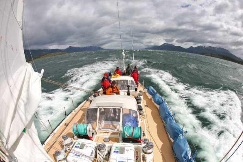 The Alaska Eagle sails in brisk winds past South Georgia Island.