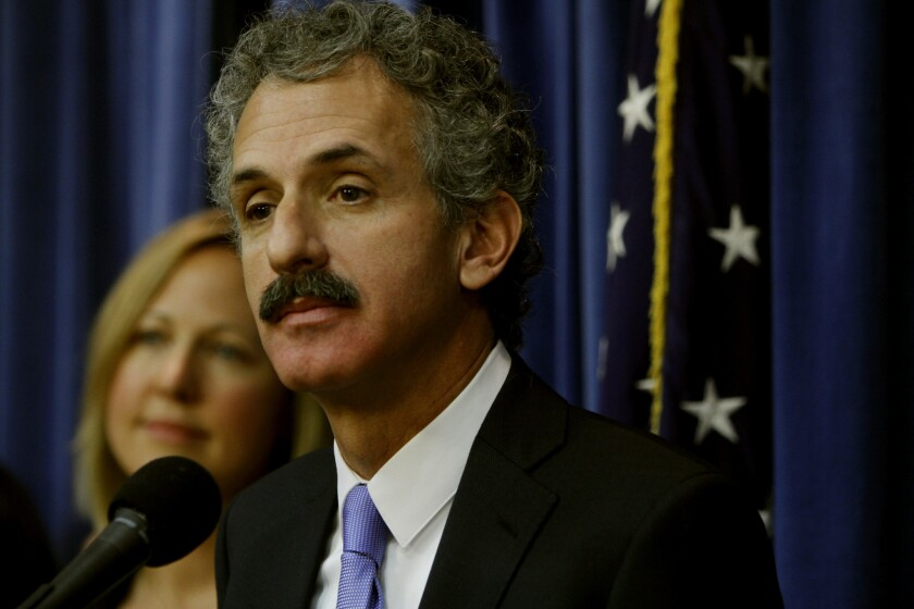 L.A. City Atty. Mike Feuer, shown in 2013, wants a judge to issue an order stopping gang members from hanging out in three apartment buildings on West 82nd Street and is suing to compel the managers to make a host of improvements.