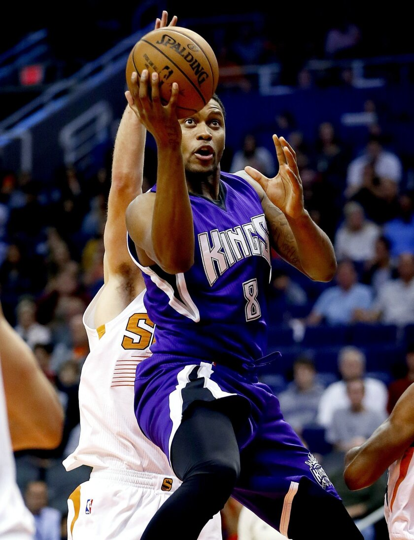 Sacramento Kings' Rudy Gay (8) drives past Phoenix Suns' Alex Len during the first half of an NBA basketball game, Wednesday, Nov. 4, 2015, in Phoenix. (AP Photo/Matt York)