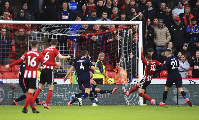 Sheffield United's Billy Sharp, second right, scores against Bournemouth during the English Premier League soccer match at Bramall Lane, Sheffield, England, Sunday Feb. 9, 2020. (Danny Lawson/PA via AP)