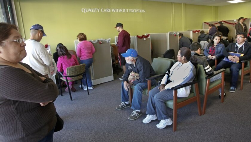 Los Angeles residents wait to sign up for health insurance starting Jan. 1 at an AltaMed enrollment center in late December.