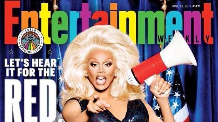 "RuPaul, in drag, is on the cover of Entertainment Weekly's annual LGBTQ special issue: ""Red, White a"