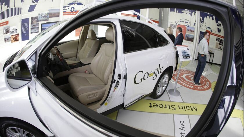FILE - In this photo Wednesday, May 14, 2014 file photo, a Google self-driving car is on exhibit at