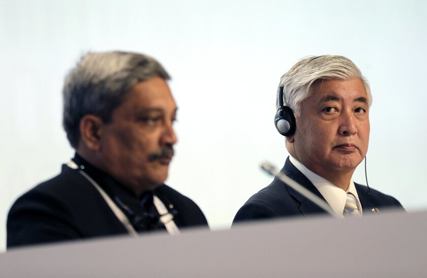 Japan's Defense Minister Gen Nakatani, right, sits with India's Defense Minister, Manohar Parrikar at the 15th International Institute for Strategic Studies Shangri-la Dialogue, or IISS, Asia Security Summit on Saturday, June 4, 2016, in Singapore. (AP Photo/Wong Maye-E)