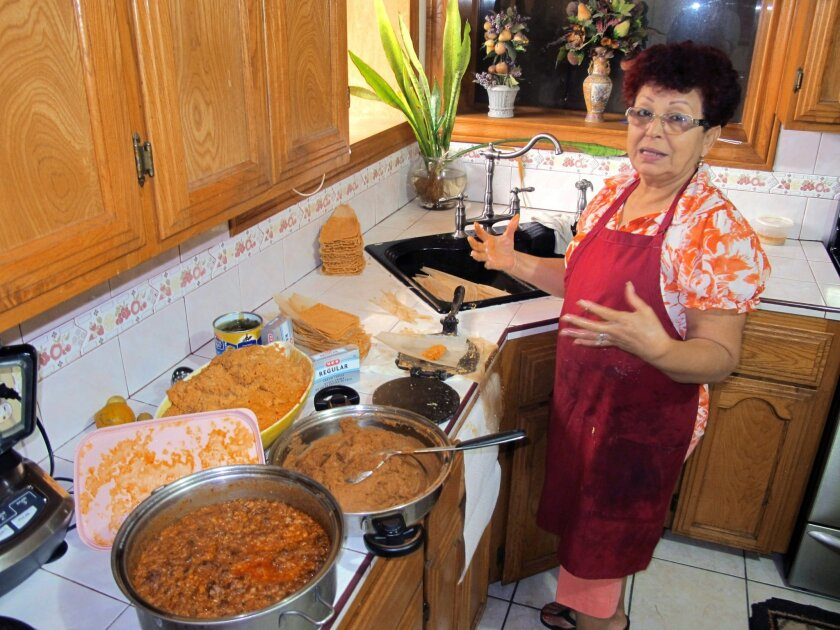 Hilda Vasquez makes tamales in her kitchen in Edinburg, Texas on Wednesday, Dec. 4, 2013.Vasquez raised the $680 for her U.S. citizenship application by selling batches of homemade tamales at South Texas offices. Immigration advocates are concerned comprehensive immigration reform proposals, which could more than triple the cost of legalization and citizenship for those illegally in the country, will make the financial hurdles almost impassable. (AP Photo/Christopher Sherman)