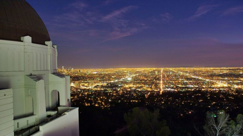 A view of the LA basin at dusk from the western side of the Samuel Oschin Planetarium dome of Griffith Observatory.