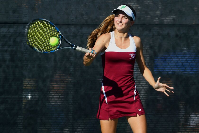 On the advice of her father, Mission Hills senior Gillian Parker tries to attack the net.