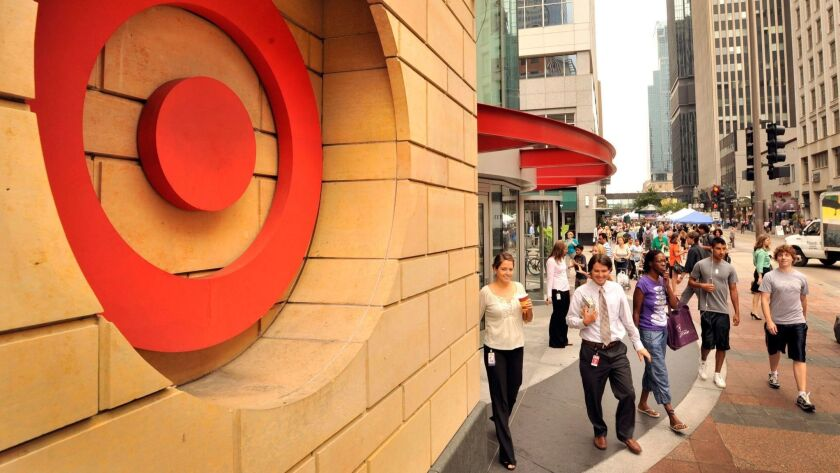 Pedestrians outside a Target store in Minneapolis in 2010. Target reported its best sales growth in 13 years on Wednesday.