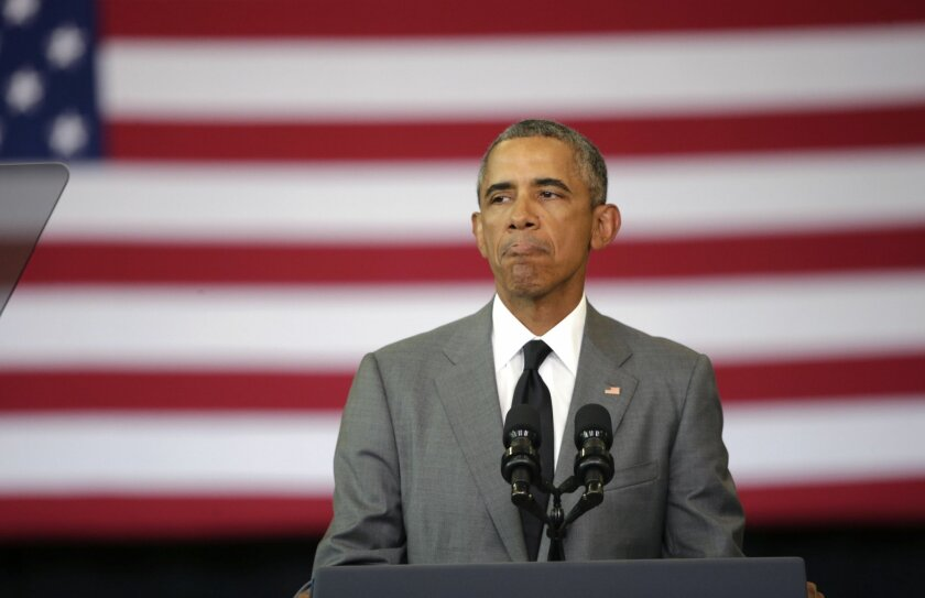 President Barack Obama pauses as he delivers remarks at an event commemorating the tenth anniversary of Hurricane Katrina in New Orleans, Thursday, Aug. 27, 2015. (AP Photo/Gerald Herbert)