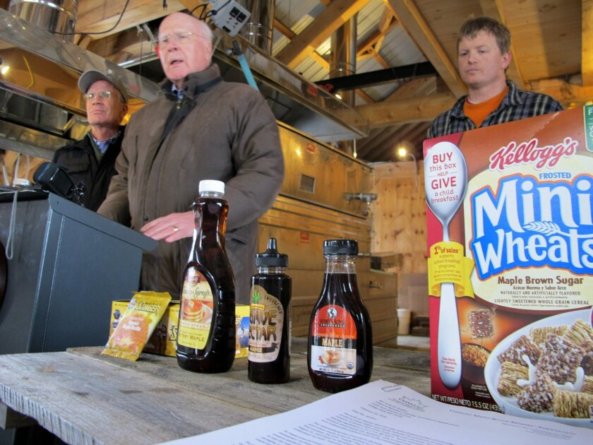 CORRECTS IDENTITY OF MAN AT LEFT TO PETER WELCH - U.S. Rep. Peter Welch, D-Vt., left, is joined by U.S. Sen. Patrick Leahy, D-Vt., center, and Roger Brown, of Slopeside Syrup, right as they talk about a request by maple producers that the Food and Drug Administration crack down on food producers wh