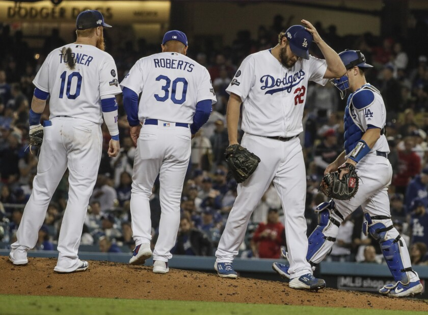 Dodgers relief pitcher Clayton Kershaw (22) leaves the game after giving up a homer to Washington Nationals left fielder Juan Soto (22) in Game 5 of the NLDS at Dodger Stadium on Wednesday.