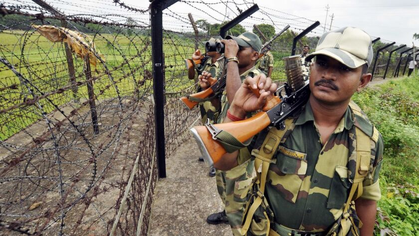 Indian Border Security Force personnel patrol the Bangladesh border at the Lankamura post in Agartala.